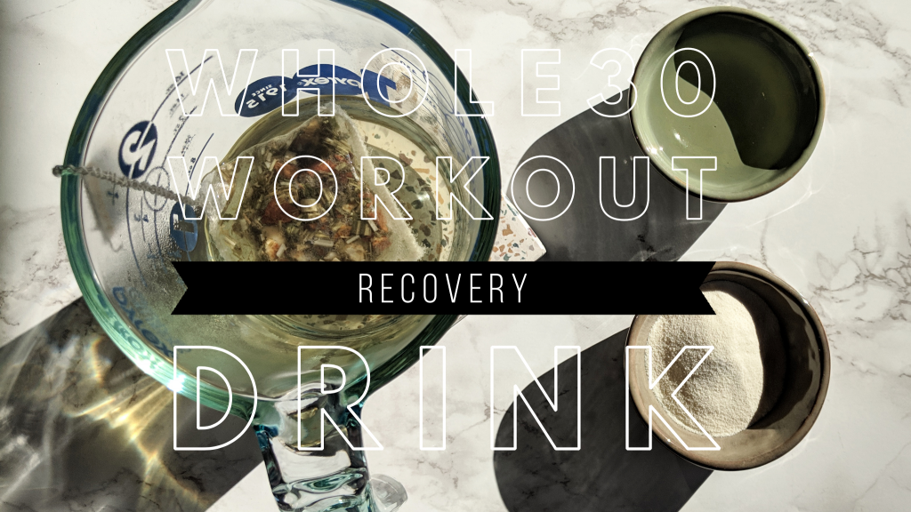 "The title image for this post. An overhead shot of the ingredients needed to make the workout recovery drink with a text overlay that reads ""Whole30 Workout Recovery Drink"". There is a 2cup clear glass measuring cup with a tea bag inside, as well as two small bowls. A small green bowl with a clear liquid and a small beige bowl with a white powder."